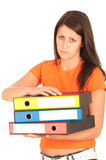 Cute young girl carries file folders Royalty Free Stock Photos