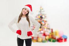 Cute young girl celebrating Christmas at home Stock Photos