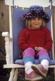 Cute young girl in a chair Royalty Free Stock Image