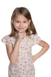 Cute young girl. A closeup portrait of a cute young girl on the white background Stock Photography