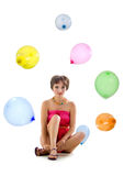 Cute young girl with colorful balloons Royalty Free Stock Images