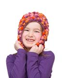 Cute young girl with colorful hat Stock Images