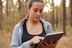 Cute young girl concentrating on tablet Royalty Free Stock Photography