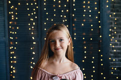 Cute young girl on a dark background. Portrait of cute young girl on a dark background Stock Image
