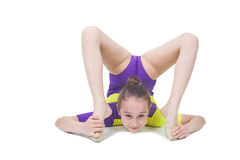 Cute young girl doing gymnastics Royalty Free Stock Photos