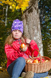 Cute young girl eating fresh autumn apples Stock Photo