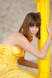 Cute young girl in fashion yellow dress Stock Photography