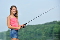 Cute young girl fishing Royalty Free Stock Photo