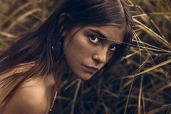 Cute young girl with freckles close up portrait stock photo