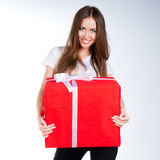 Cute young girl with a gift Royalty Free Stock Photo