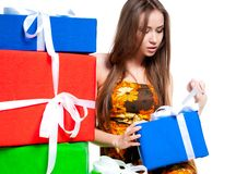 Cute young girl with a gift Stock Photos