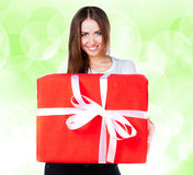 Cute young girl with a gift Royalty Free Stock Images