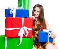 Cute young girl with gifts Stock Photo