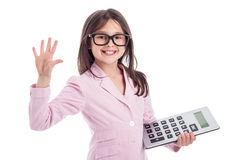 Cute Young Girl with Glasses and Calculator. Young girl counting a calculator and holding up five fingers. Isolated on white background Stock Photography