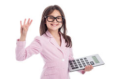 Cute Young Girl with Glasses and Calculator. Young girl counting a calculator and holding up four fingers. Isolated on white background Stock Photos