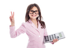 Cute Young Girl with Glasses and Calculator. Royalty Free Stock Image
