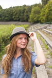 Cute young girl in a hat in a historic park. Stock Images
