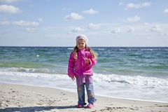 Cute young girl having fun on the beach Royalty Free Stock Photography