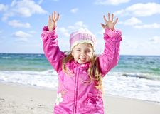 Cute young girl having fun on the beach Royalty Free Stock Photo
