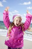 Cute young girl having fun on the beach Stock Images
