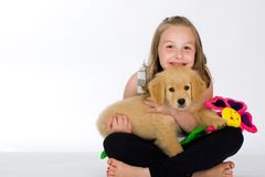 A cute young girl and her puppy royalty free stock photos
