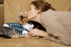 Cute young girl with her Yorkie puppy Stock Images
