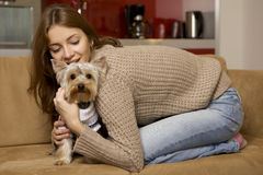 Cute young girl with her Yorkie puppy royalty free stock photography