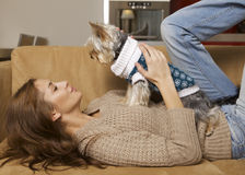 Cute young girl with her Yorkie puppy Stock Photos