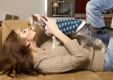 Cute young girl with her Yorkie puppy Stock Photo