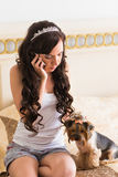 Cute young girl with her Yorkie puppy Royalty Free Stock Images