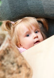 Cute young girl hiding Royalty Free Stock Image