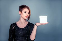 Cute young girl holding box on a hand Royalty Free Stock Images