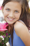 Cute Young Girl Holding Flower Bouquet at the Market Royalty Free Stock Images