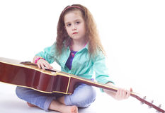 young girl and guitar Royalty Free Stock Photo