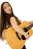 Cute young girl holding a guitar leaning back Stock Photos
