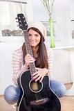 Cute young girl holding the guitar Stock Images