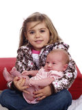 Cute Young Girl Holding Infant Baby Sitting Royalty Free Stock Photos