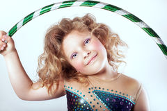 Cute young girl with hulahop Royalty Free Stock Photo
