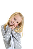 Cute young girl with innocent gesture her hands folded Stock Photography