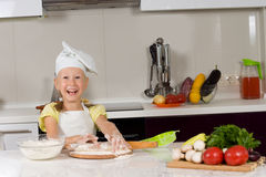 Cute young girl in the kitchen Stock Photos