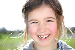 Cute young girl laughing outdoors Stock Photo
