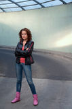 Cute young girl in leather jacket Royalty Free Stock Image