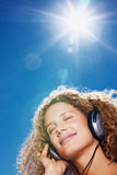 Cute young girl listening to music with headphones Stock Photos