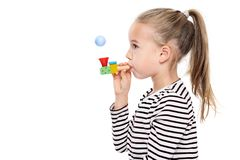 Cute young girl making special exercises at speech therapy office. Child speech therapy concept on white background. Speech impediment corrective exercises stock photo
