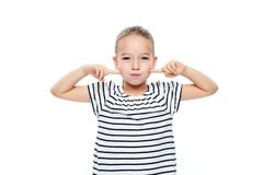 Cute young girl making special exercises at speech therapy office. Child speech therapy concept on white background. Speech impediment corrective exercises royalty free stock photo