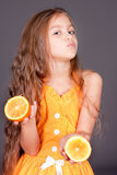 Cute young girl with oranges Royalty Free Stock Photos