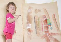 Cute young girl painting stock image