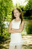 Cute young girl in park stock image