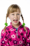 Cute young girl in pigtails against white Stock Photo