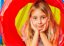 Cute Young Girl Playing. Outside in Colorful Tunnel Royalty Free Stock Photos